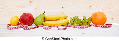 Fruits on a wooden background