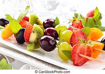 Fruits on sticks.
