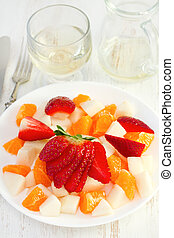 fruits on the white plate with wine