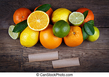 Fruits on wood background with space for text. Organic food.