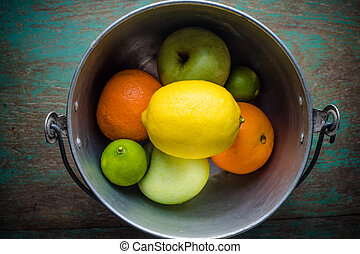 Fruits (orange, lemon,  lime and apples) on wooden table.