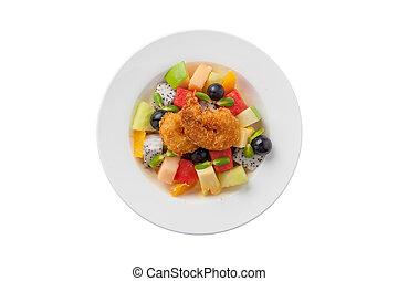 Fruits salad in ceramic dish