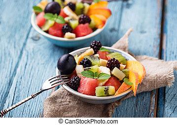 Fruits salad with watermelon, banana and kiwi