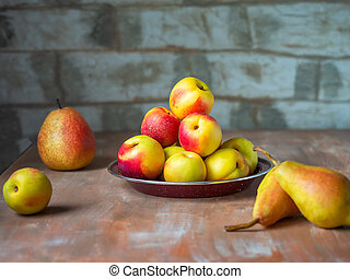 Fruits set of ripe fruits on rustic kitchen wooden table