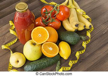 fruits, vegetables, juice, measuring tape on wooden surface