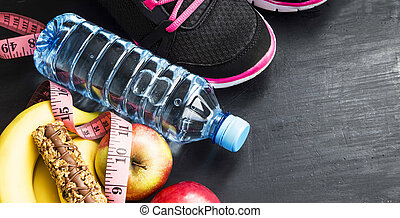 Fruits, water bottle and training shoes, sport itmes, healthy lifestyle
