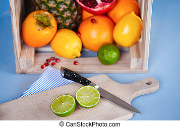Fruits with chopping block and knife on the table