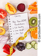 Fruits with vegetables and new year resolutions for 2019 in notepad