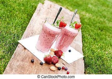 Fruity berry milkshake outdoors