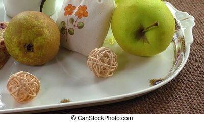 Fruity breakfast and cake on a white plate