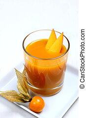 Fruity mango smoothie with physalis