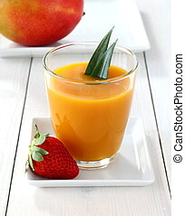 Fruity mango smoothie with strawberry