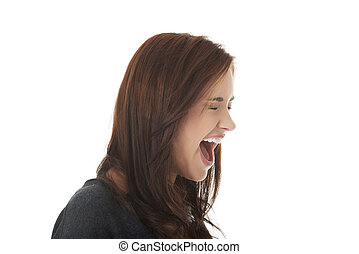 Frustrated and angry woman screaming.