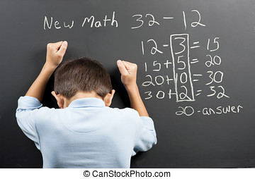 Frustrated at the new math. - A student is showing his...