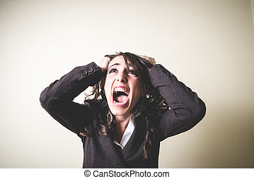 frustrated beautiful young businesswoman on gray background