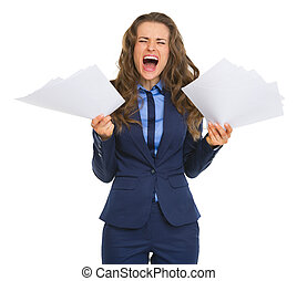 Frustrated business woman with documents