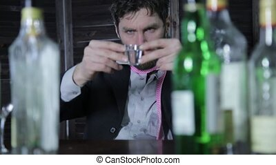 frustrated businessman gets drunk alone at the bar. failures...