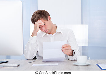 Frustrated Businessman Holding Paper
