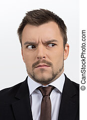 Frustrated businessman. Portrait of shocked businessman looking away while isolated on white