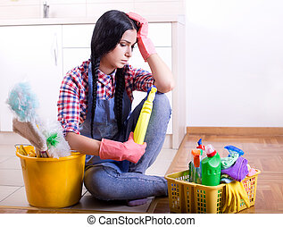 Frustrated cleaning lady - Tired young woman sitting on...