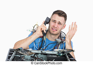 Frustrated computer engineer on call in front of open cpu - ...