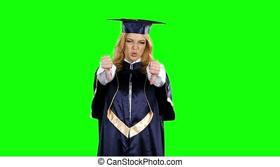 Frustrated graduate shows two thumbs down. Green screen