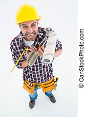 Frustrated handyman holding various tools