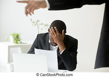 Frustrated hopeless african-american office worker getting fired