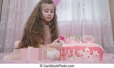 frustrated little girl near the cake