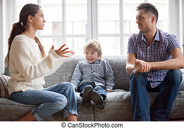 Frustrated little kid boy scared with mom and dad fighting
