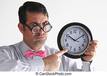 Frustrated man manager points to the time on a clock....