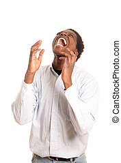 frustrated man shouting - a dark skinned man shouting while...