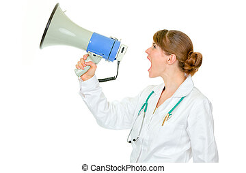 Frustrated medical doctor woman yelling through megaphone isolated on white