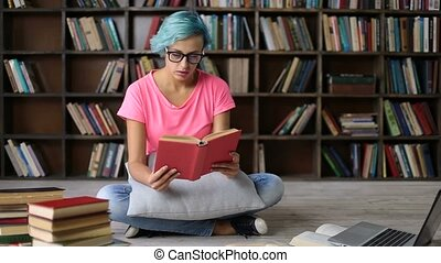 Frustrated overworked student girl reading a book
