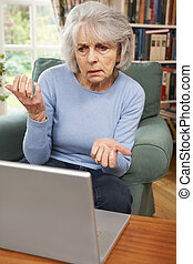 Frustrated Senior Woman Using Laptop