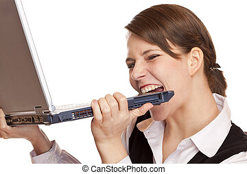 Frustrated stressed business woman bites in laptop. Isolated...