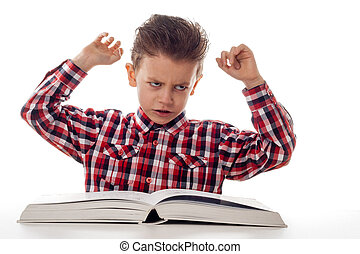 frustrated student - young boy being frustrated by studying...