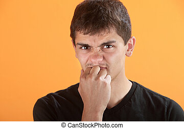 Frustrated Teen - Frsturated Latino teen with knuckles in...