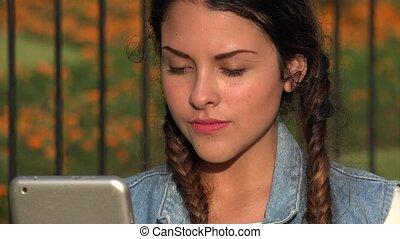 Frustrated Teen Girl With Broken Tablet