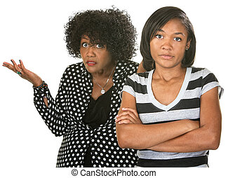 Frustrated Teen with Parent - Teen with folded arms next to ...