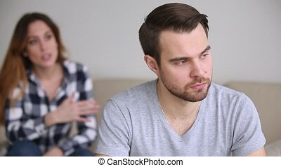 Frustrated upset man turned away ignoring wife arguing...