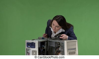 Frustrated woman office worker holding hard disk drive...