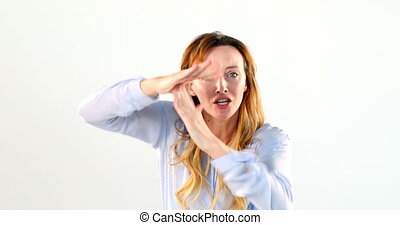 Frustrated woman standing against white background 4k