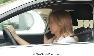 Frustrated woman stuck in a traffic jam. girl talking on the...
