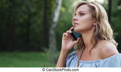 frustrated woman swearing on phone, close-up