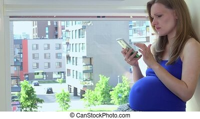Frustrated woman using smart phone and showing negative emotions