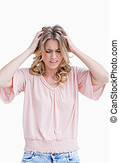 Frustrated woman with her hands in her hair