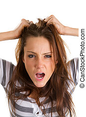 Frustrated Woman - Woman pulls her hair in frustration.