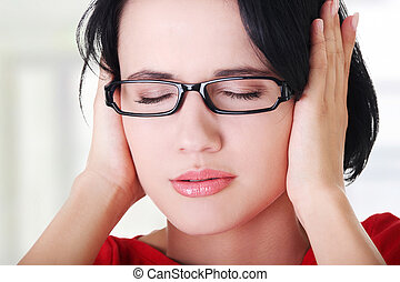 Frustrated young woman holding her ears - Closeup of ...