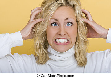 Frustration - A beautiful young blue eyed blond woman...